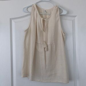 Cream sleeveless top size L